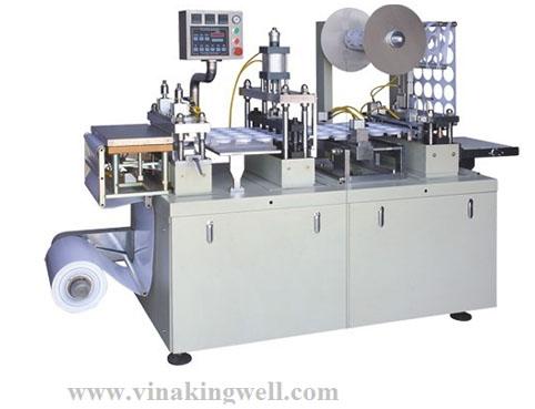 Lid making machine